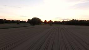 Farmland Aerial. V1 Flying low over farmland at sunrise stock footage