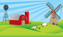 Farmland with barn and windmill Royalty Free Stock Images