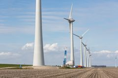 Farmland with construction work at the biggest windfarm of the Netherlands Stock Photo