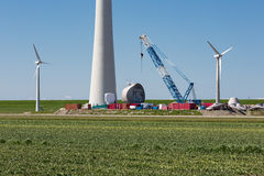 Farmland with construction work at the biggest windfarm of the Netherlands Stock Images