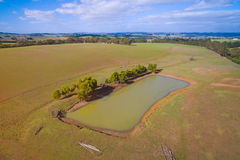 Farmland with dam in Australia. Dam in rural farmland in South Gippsland, Australia Stock Images