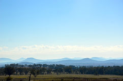 Farmland, forest and mountain landscape Stock Photo