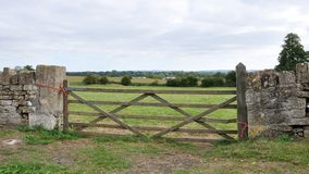 Farmland Gate. Old Wooden Gate to a Farmland Field Stock Image