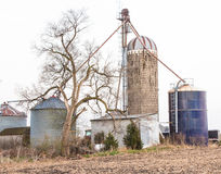 Farmland. Grain Bins & Shed in Prairie City Iowa Stock Image