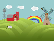 Farmland with green hills. Farmland with barn, windmill and sheep grazing Royalty Free Stock Image