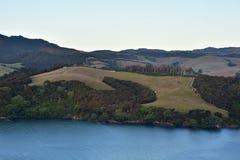 Farmland on hills above sea Royalty Free Stock Photography