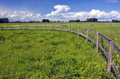 Farmland landscape with wooden fence Stock Photos
