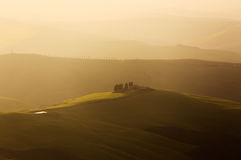 Farmland near Volterra, rolling hills on sunset. Rural landscape Stock Images