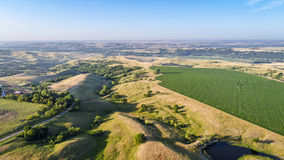 Farmland in Nebraska Sandhills - aerial view. In morning summer scenery Royalty Free Stock Photography