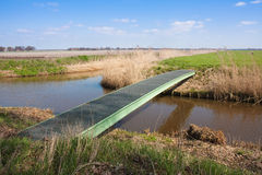 Farmland with pedestrian bridge crossing a ditch Stock Photography
