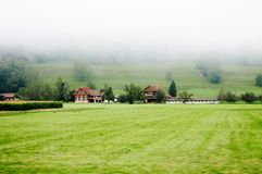 Farmland and rural cottages in biosphere reserve of Entlebuch, Switzerland royalty free stock photos
