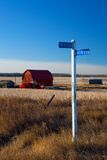 Farmland Sign. A rural sign on prairie land marks the location. Shallow depth of field - sign in focus stock photos