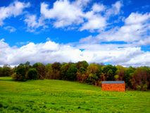 Farmland in Simsbury Connecticut. Open filed in the summer with a red barn in simsbury connecticut United States Stock Photography