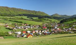 Farmland, small town and forested hills. Royalty Free Stock Photo