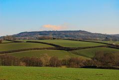 Farmland in Somerset, England. Fields and agricultural farmland countryside scene in Somerset, England, UK Royalty Free Stock Photo