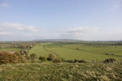 Farmland on the Somerset Levels of South West England. Farmland stretches out on the Somerset Levels England viewed from the ancient Burrow Mump Hill Stock Images