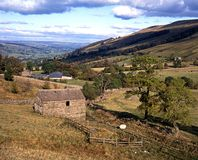 Farmland, Wharfdale, England. View of farmland and surrounding countryside, Wharfdale, Yorkshire Dales, North Yorkshire, England, UK, Great Britain, Western Royalty Free Stock Image