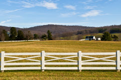 Farmland with White Fence Foreground Royalty Free Stock Photos