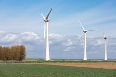 Farmland with wind turbines of the biggest windfarm in the Netherlands Stock Photos