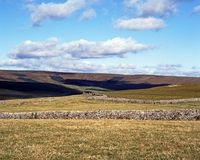 Farmland in the Yorkshire Dales. View across farmland and hills in the Yorkshire Dales, Malham, Yorkshire Dales, North Yorkshire, England, UK, Great Britain Royalty Free Stock Images