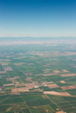 Farmlands View From A Plane. A view of the vast farmlands from a plane window Royalty Free Stock Photos