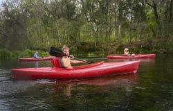 Farmor och sonsoner som Kayaking Fotografering för Bildbyråer