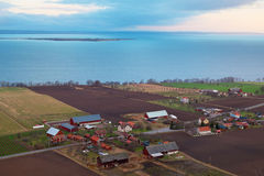 Farms along lake Vättern. Elevated view over farms and houses along lake Vättern in Sweden Stock Photo