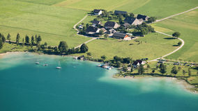 Farms at an Alpine Lake, Austria Stock Photo