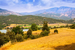 Farms and fields in valley Stock Photography