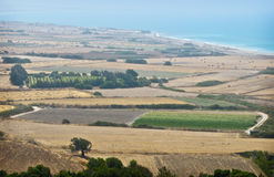 Farms on the Island of Cyprus, in Coastal Mist. The vast agricultural fields at the coast of the island of Cyprus create a panoramic tapestry on the misty Stock Photography