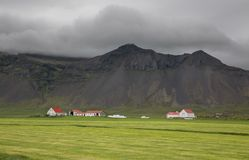 Farms and Mountains in Iceland. Iceland landscape with farms and volcanic mountains Royalty Free Stock Photography