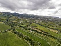 Farms on Sao Miguel. Aerial view of fields and houses near the small village of Ginetes on Azorean island of Sao Miguel in Portugal stock image