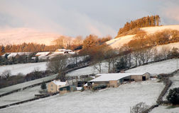 Farms in snow Royalty Free Stock Image
