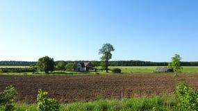 Farmy i wiosny pole, Lithuania Fotografia Royalty Free