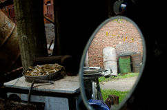 Farmyard in the rear view mirror 1. Reflection of the farmyard in the rear view mirror Royalty Free Stock Image