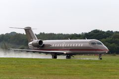 Bombardier Coprorate jet CL-600-2B19 OY-NNA. Farnborough, UK - July 19, 2014: Bombardier Coprorate jet CL-600-2B19 OY-NNA royalty free stock images