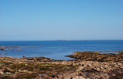 The Farne Isles from Seahouses on hazy summer day. View from Seahouses to Farne Isles on hazy summer day Royalty Free Stock Photos