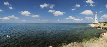 Faro al litorale di mare Immagine Stock Libera da Diritti