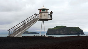 Faro all'isola di Heimaey, Islanda Fotografia Stock