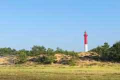 Faro alla spiaggia Immagini Stock Libere da Diritti