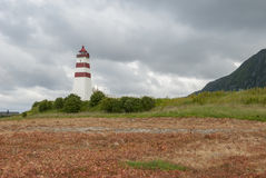 Faro Alnes sull'isola di Godoya in Norvegia Immagini Stock