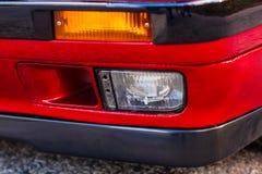 Faro antinebbia di un'automobile rossa, vecchia, retro fotografia stock libera da diritti