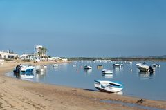 Faro Beach is located on the Ancão Peninsula royalty free stock photography
