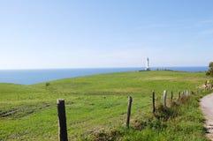 Faro blanco en Asturias, España Fotos de archivo