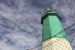 Faro colorido en el muelle fotografía de archivo libre de regalías