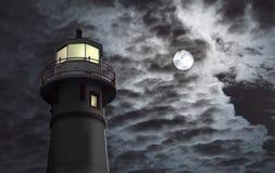 Faro con la luna Fotos de archivo