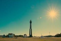 Faro con puesta del sol fotografía de archivo libre de regalías
