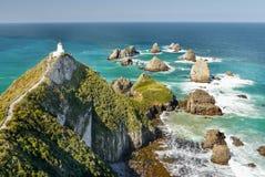Faro, costa costa de South Pacific, Nueva Zelanda Fotografía de archivo