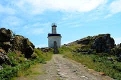 Faro da Porta lighthouse (Islas Cies, Spain). Small lighthouse on the Faro island (Islas Cies, Galicia, Spain stock image