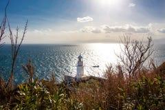 Faro dall'oceano fotografia stock